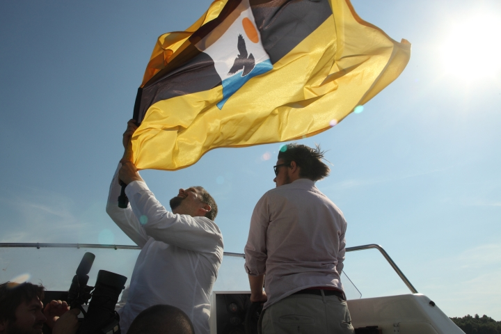 LSA boss Niklas Nikolajsen holding Liberland flag on one of the 2 LSA boats