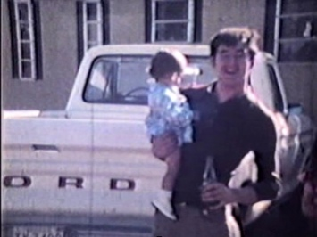 "The man joyfully standing at the back of his Ford pickup was Mike Carroll's brother Pete ""Worm"" Carroll holding his daughter Nora Rita Carroll, 1976"